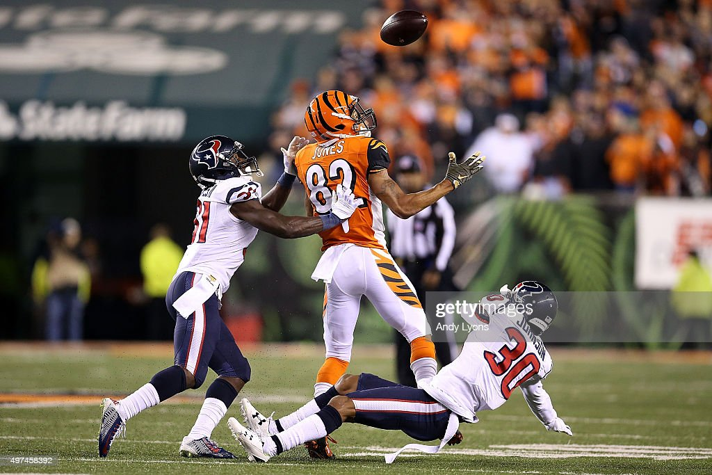 Marvin Jones of the Cincinnati Bengals is unable to catch the ball while being defended by Charles James II of the Houston Texans and Kevin Johnson...