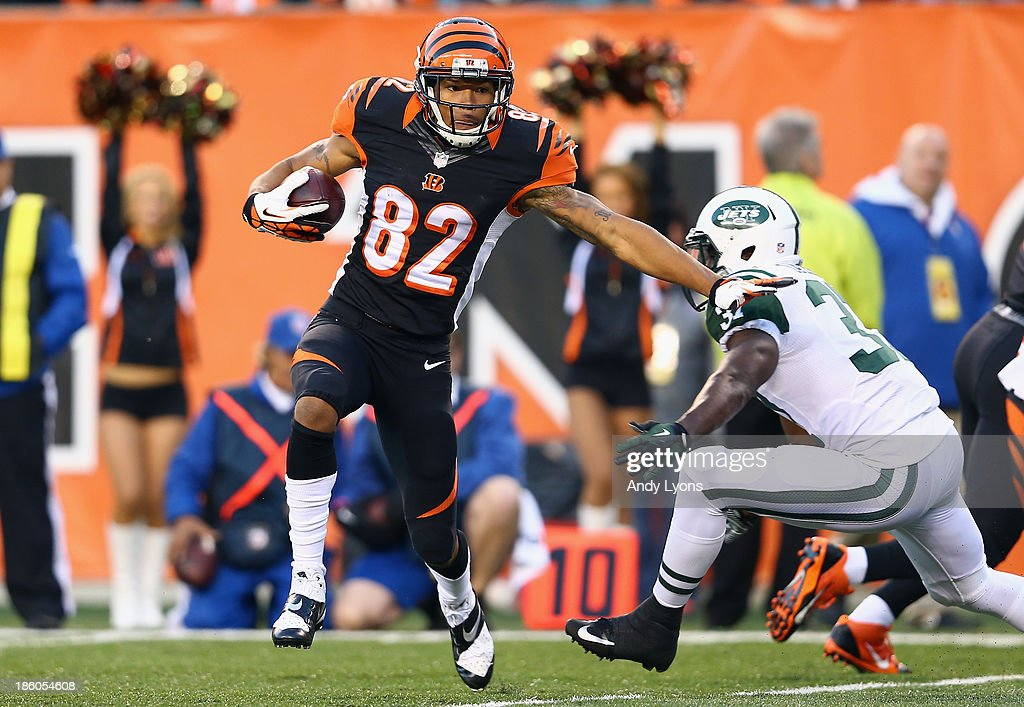 Marvin Jones #82 of the Cincinnati Bengals runs for a touchdown during the NFL game against the New York Jets at Paul Brown Stadium on October 27, 2013 in Cincinnati, Ohio.