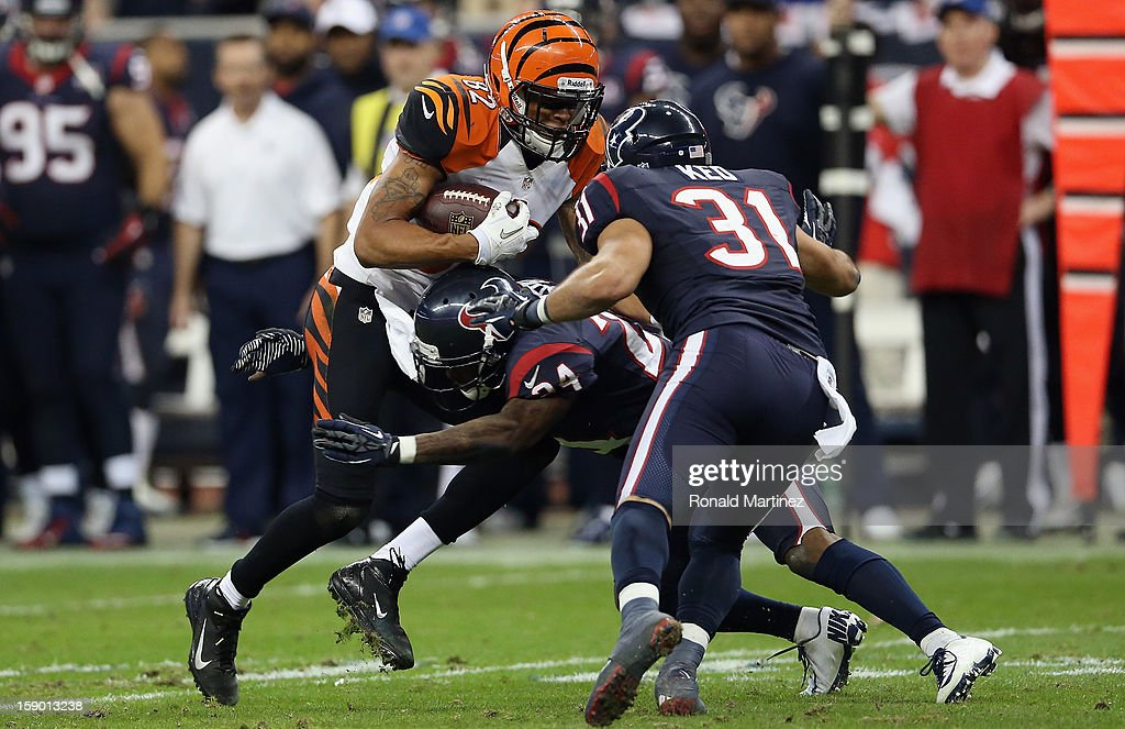 Marvin Jones #82 of the Cincinnati Bengals runs the ball against the Houston Texans during the AFC Wild Card Playoff Game at Reliant Stadium on January 5, 2013 in Houston, Texas.