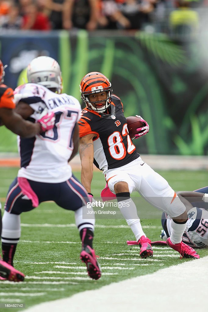 Marvin Jones #82 of the Cincinnati Bengals runs the ball upfield during the game against the New England Patriots at Paul Brown Stadium on October 6, 2013 in Cincinnati, Ohio. The Bengals defeated the Patriots 13-6.