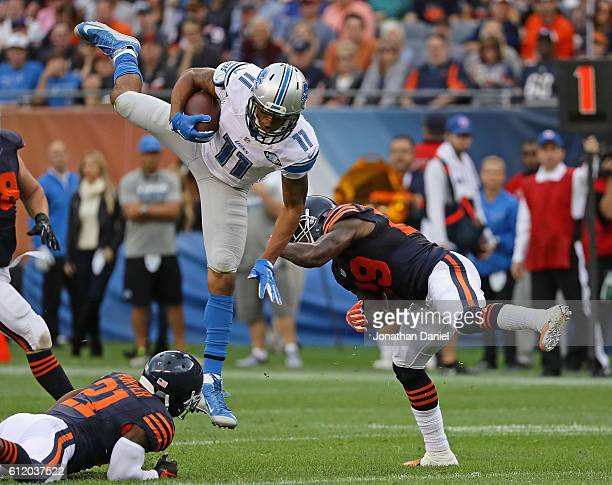 Marvin Jones of the Detroit Lions is upended by Harold JonesQuartey of the Chicago Bears at Soldier Field on October 2 2016 in Chicago Illinois
