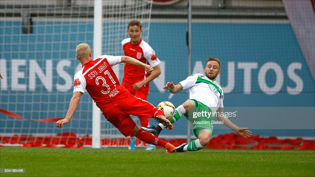Marvin Kleihs of Wolfsburg challenges Uwe Hesse of Regensburg during the 3. Liga Playoff Leg 1 match between VfL Wolfsburg II and Jahn Regensburg at AOK Stadion on May 25, 2016 in Wolfsburg, Germany.