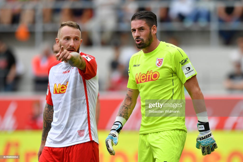Marvin Knoll and goalkeeper Philipp Pentke of SSV Jahn Regensburg talk during the Second Bundesliga match between SSV Jahn Regensburg and 1. FC Nuernberg at Continental Arena on August 6, 2017 in Regensburg, Germany.
