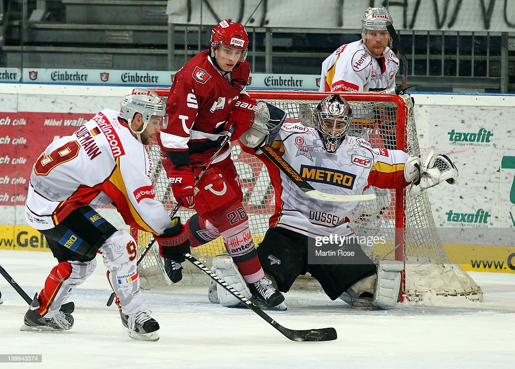 Marvin Krueger of Hannover and Evan Kaufmann of Duesseldorf battle for the puck during the DEL match between Hannover Scorpions and DEG Metro Stars...