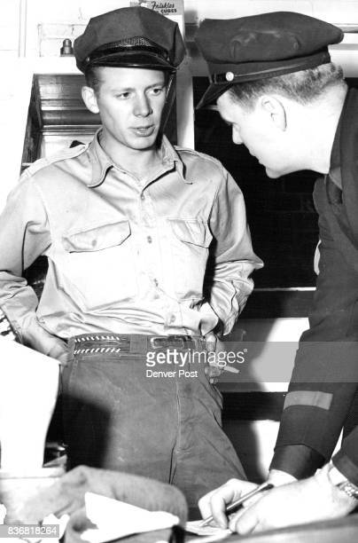 Marvin L Wilkie of 7825 West Sixty second avenue Arvada explains to Patrolman HE Mills how he shot one of the two armed men who held up a frontier...