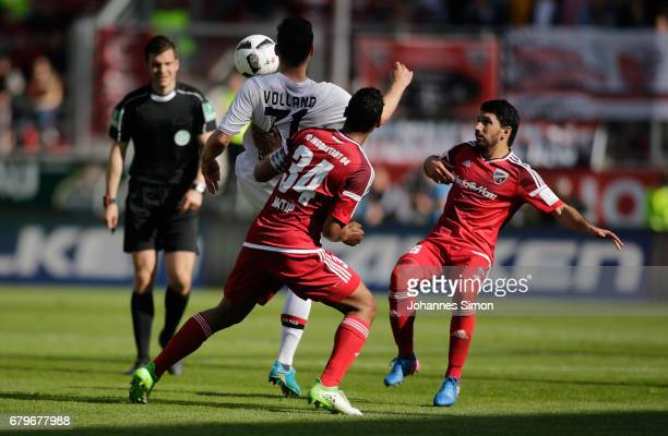 Marvin Matip and Almog Cohen of Ingolstadt and Kevin Volland of Leverkusen fight for the ball during the Bundesliga match between FC Ingolstadt 04...