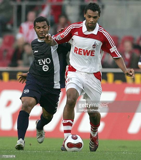 Marvin Matip of Cologne controls the ball beside Sidney of Offenbach during the Second Bundesliga match between 1 FC Cologne and Kickers Offenbach at...