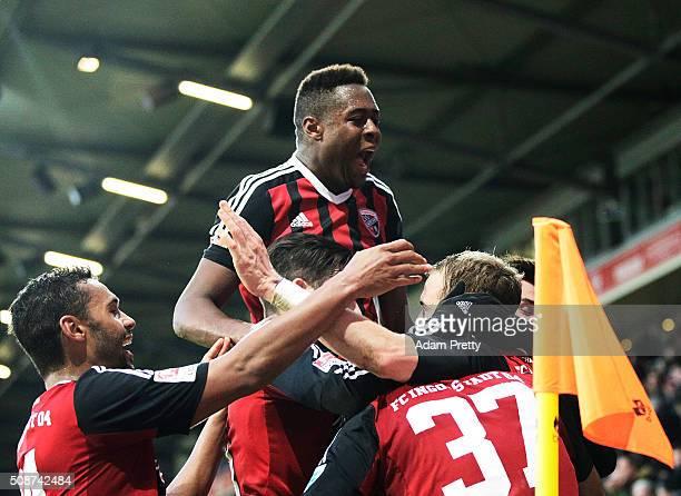 Marvin Matip of Ingolstadt 04 is congratulated by Bernardo De Oliviera of Ingolstadt 04 after scoring a goal during the Bundesliga match between FC...