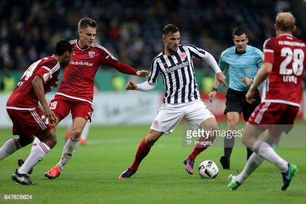 Marvin Matip of Ingolstadt Max Christiansen of Ingolstadt Haris Seferovi of Frankfurt Tobias Levels of Ingolstadt battle for the ball during the...
