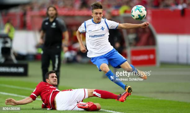 Marvin Mehlem of Darmstadt challenges Benjamin Kessel of Kaiserslautern during the Second Bundesliga match between 1 FC Kaiserslautern and SV...