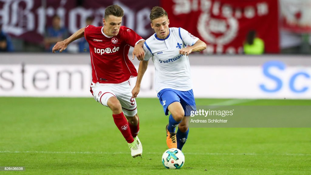 Marvin Mehlem of Darmstadt challenges Gino Fechner of Kaiserslautern during the Second Bundesliga match between 1. FC Kaiserslautern and SV Darmstadt 98 at Fritz-Walter-Stadion on August 4, 2017 in Kaiserslautern, Germany.