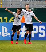 Marvin Mehlhem of Germany celebrates after scoring his team's third goal with his teammate Maximilian Mittelstaedt during the UEFA Under19 European...