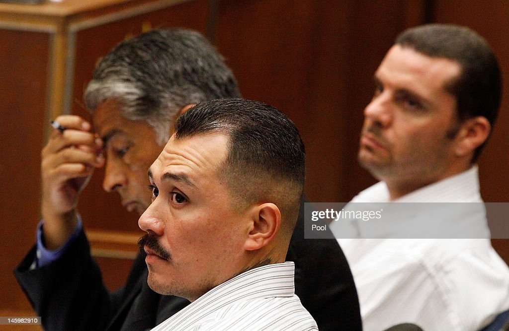 Marvin Norwood, his attorney Victor Escobedo and co-defendant Louie Sanchez listen during preliminary proceedings in Superior Court June 8, 2012. in Los Angeles, California. Superior Court judge George G. Lomeli has ordered Norwood and Sanchez to stand trial on charges they assaulted San Francisco Giants fan Bryan Stow at Dodger Stadium in 2011. The decision caps a six-day preliminary hearing that included dramatic testimony from witnesses who recalled Stow being assaulted as well as a recording of Norwood admitting to his mother that he was 'involved' in the opening day beating.