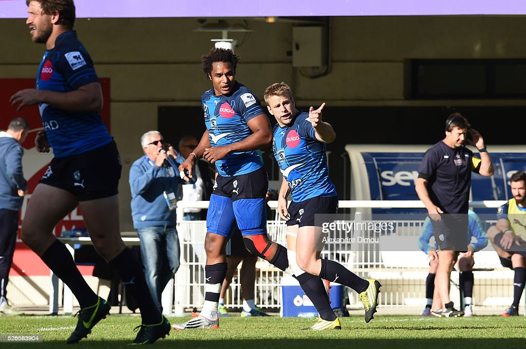Marvin O'Connor of Montpellier and Benjamin Fall of Montpellier celebrate the first try for Montpellier during the French Top 14 rugby union match between Montpellier v Grenoble on April 30, 2016 in Montpellier, France.