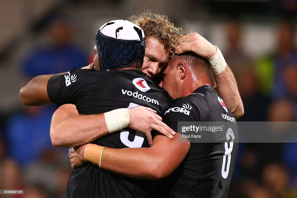 Marvin Orie, Gerhardus Snyman and Hanro Liebenberg of the Bulls celebrates after a try during the round 10 Super Rugby match between the Force and the Bulls at nib Stadium on April 29, 2016 in Perth, Australia.