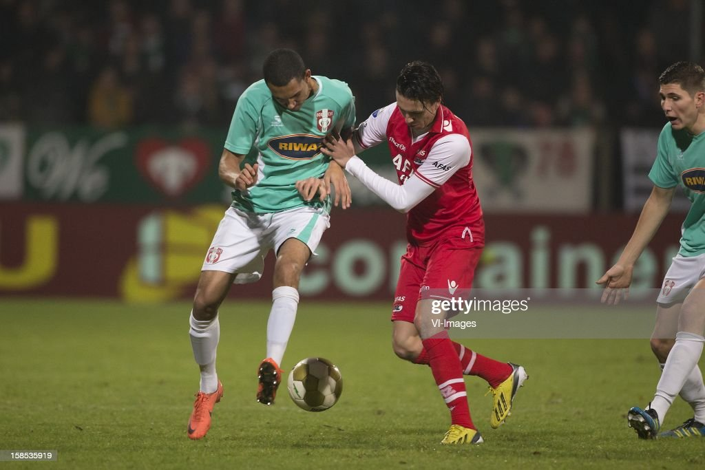 Marvin Peersman of FC Dordrecht, Steven Berghuis of AZ during the Dutch Cup match between FC Dordrecht and AZ Alkmaar at the GN Bouw Stadium on December 18, 2012 in Dordrecht, The Netherlands.