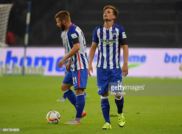 Marvin Plattenhardt and Valentin Stocker of Hertha BSC show disappointment during the game between Hertha BSC and Werder Bremen on August 21 2015 in...