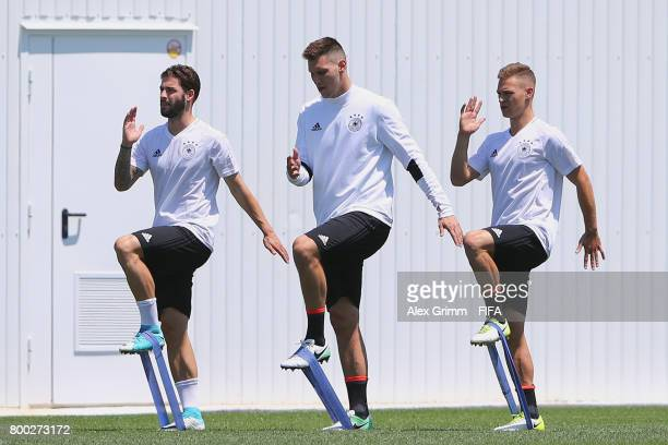 Marvin Plattenhardt Niklas Suele and Joshua Kimmich exercise during a Germany training session ahead of their FIFA Confederations Cup Russia 2017...