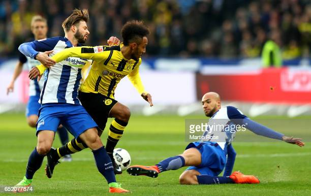 Marvin Plattenhardt of Berlin and John Anthony Brooks of Berlin challenge Pierre Emerick Aubameyang of Dortmund during the Bundesliga match between...