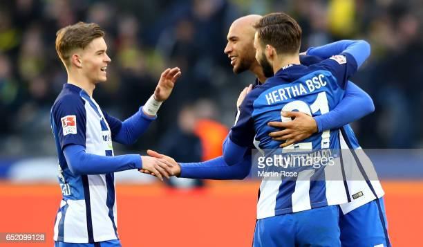 Marvin Plattenhardt of Berlin celebrates with team mates after winning the Bundesliga match between Hertha BSC and Borussia Dortmund at...