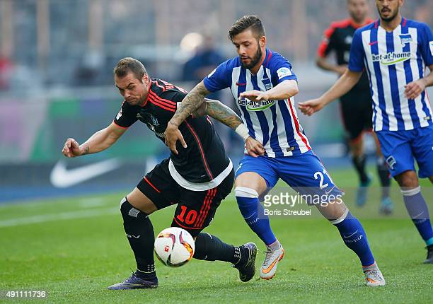 Marvin Plattenhardt of Berlin challenges PierreMichel Lasogga of Hamburger SV during the Bundesliga match between Hertha BSC and Hamburger SV at...