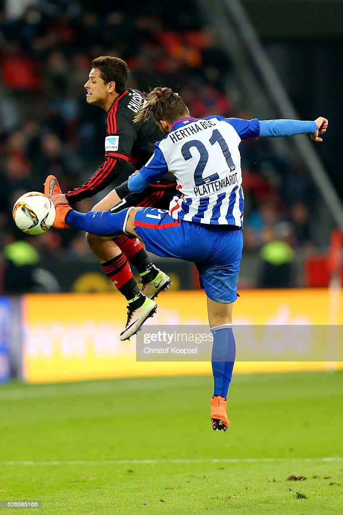 <a gi-track='captionPersonalityLinkClicked' href=/galleries/search?phrase=Marvin+Plattenhardt&family=editorial&specificpeople=5616506 ng-click='$event.stopPropagation()'>Marvin Plattenhardt</a> of Berlin (R) fouls Chicharito of Leverkusen (L) after the Bundesliga match between Bayer Leverkusen and Hertha BSC Berlin at BayArena on April 30, 2016 in Leverkusen, Germany. The match between Leverkusen and Belrin ended 2-1.