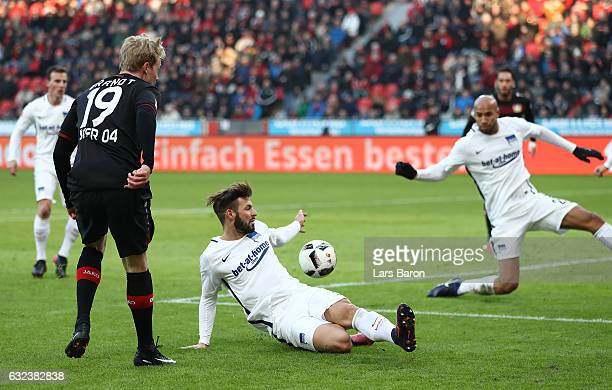 Marvin Plattenhardt of Berlin hand balls the ball leading to a penatly during the Bundesliga match between Bayer 04 Leverkusen and Hertha BSC at...
