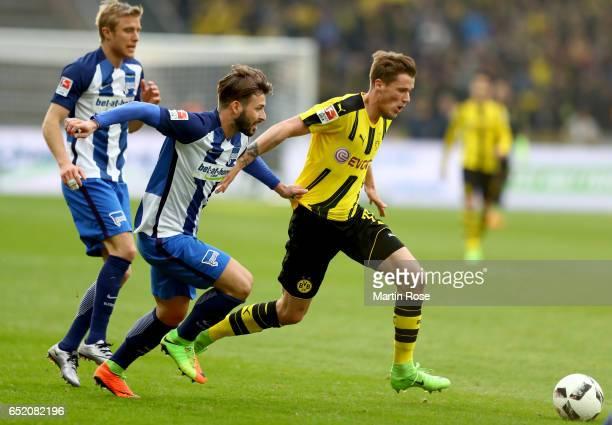 Marvin Plattenhardt of Berlin holds Erik Durm of Dortmund during the Bundesliga match between Hertha BSC and Borussia Dortmund at Olympiastadion on...