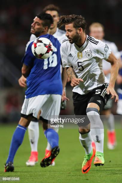 Marvin Plattenhardt of Germany and Danilo Rinaldi of San Marino battle for the ball during the FIFA 2018 World Cup Qualifier between Germany and San...