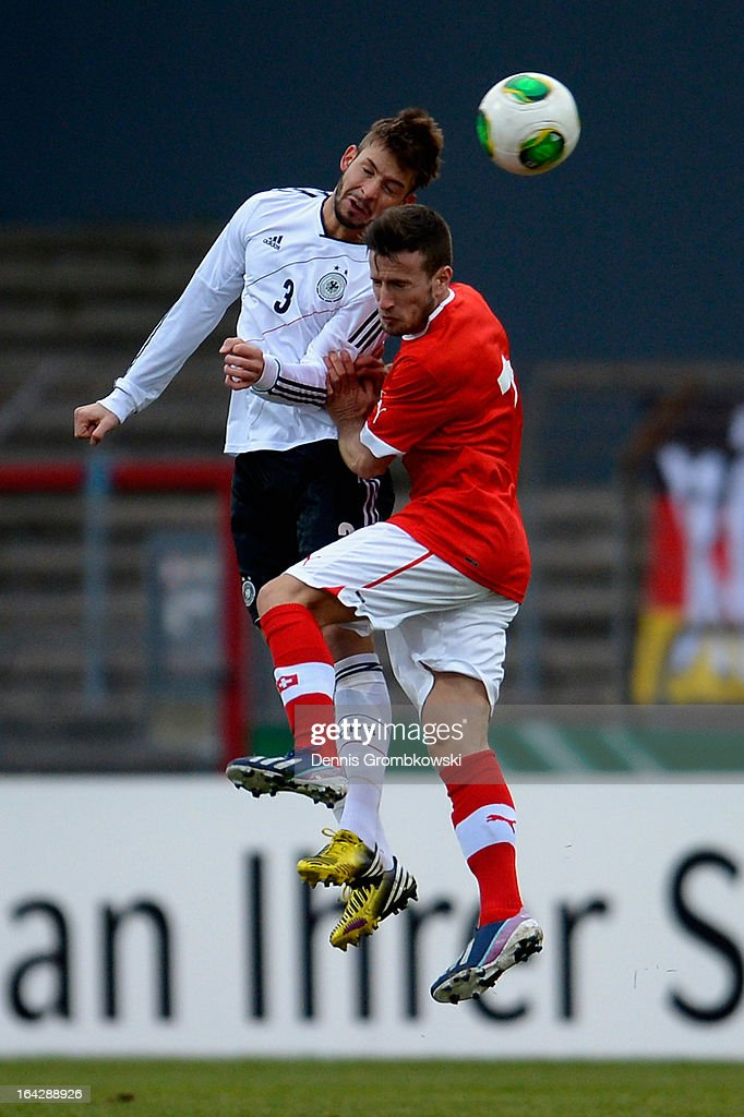 Marvin Plattenhardt of Germany and Mergim Brahimi of Switzerland go up for a header during the International Friendly match between U20 Germany and U20 Switzerland on March 22, 2013 in Cologne, Germany.