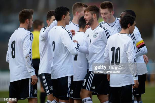 Marvin Plattenhardt of Germany celebrates with teammates after scoring his team's first goal during the International Friendly match between U20...