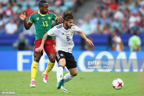 Marvin Plattenhardt of Germany is challenged by Christian Bassogog of Cameroon during the FIFA Confederations Cup Russia 2017 Group B match between...