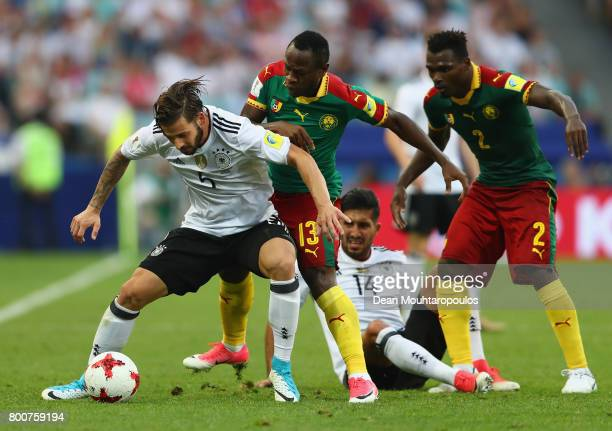 Marvin Plattenhardt of Germany is put under pressure from Christian Bassogog of Cameroon during the FIFA Confederations Cup Russia 2017 Group B match...