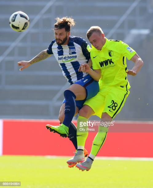 Marvin Plattenhardt of Hertha BSC and Georg Teigl of FC Augsburg during the game between Hertha BSC and FC Augsburg on April 9 2017 in Berlin Germany