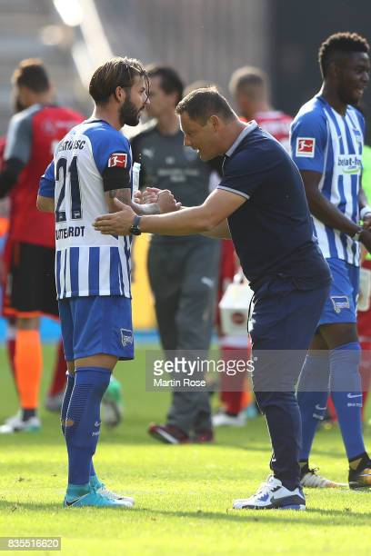 Marvin Plattenhardt of Hertha BSC Berlin and coach Pal Dardai of Hertha BSC Berlin celebrate their team's victory after the Bundesliga match between...
