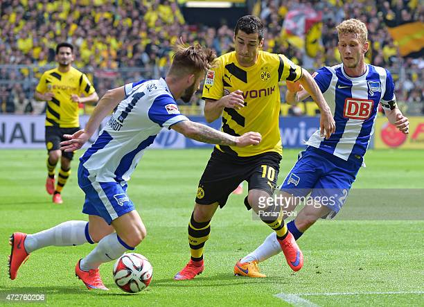 Marvin Plattenhardt of Hertha BSC handles the ball against Henrikh Mkhitayan of Borussia Dortmund during the game between Borussia Dortmund and...