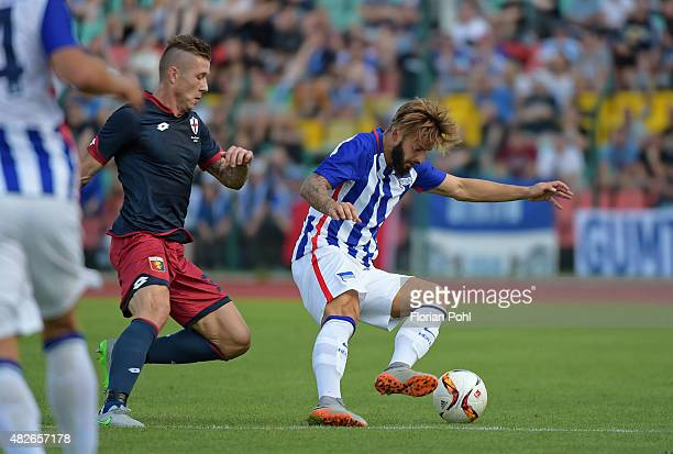 Marvin Plattenhardt of Hertha BSC handles the ball against Juraj Kucka of CFC Genua during the game between Hertha BSC and CFC Genua on august 1 2015...