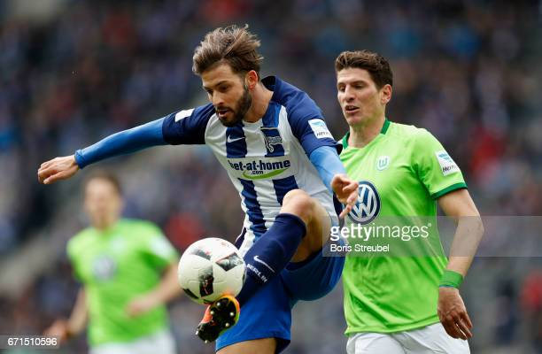 Marvin Plattenhardt of Hertha BSC is challenged by Mario Gomez of VfL Wolfsburg during the Bundesliga match between Hertha BSC and VfL Wolfsburg at...