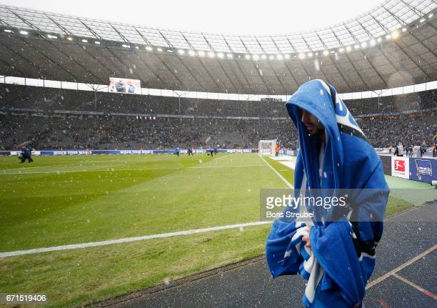 Marvin Plattenhardt of Hertha BSC protect himself against hail under the cover after the the Bundesliga match between Hertha BSC and VfL Wolfsburg at...
