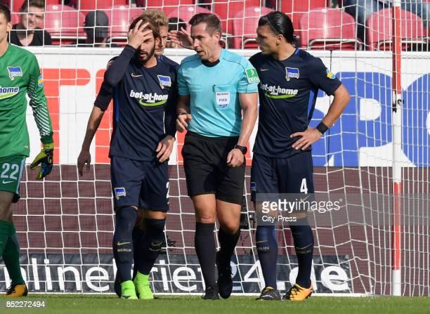 Marvin Plattenhardt of Hertha BSC referee Tobias Stieler and Karim Rekik of Hertha BSC during the game between FSV Mainz 05 and Hertha BSC on...