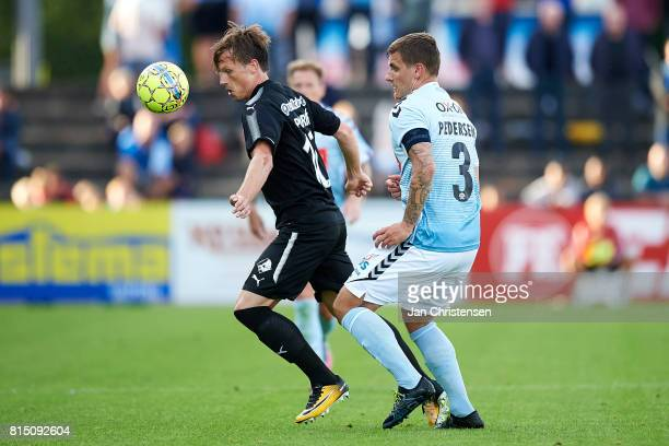 Marvin Pourié of Randers FC and Marc Pedersen of SonderjyskE compete for the ball during the Danish Alka Superliga match between SonderjyskE and...