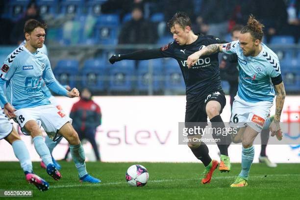 Marvin Pourié of Randers FC and Pierre Kanstrup of SonderjyskE compete for the ball during the Danish Alka Superliga match between SonderjyskE and...