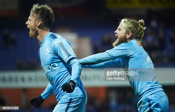 Marvin Pourie and Kasper Fisker of Randers FC celebrate after scoring their first goal during the Danish Alka Superliga match between Randers FC and...