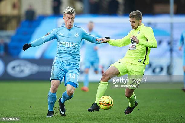 Marvin Pourie of Randers FC and Jeppe Brinch of Esbjerg fB compete for the ball during the Danish Alka Superliga match between Randers FC and Esbjerg...