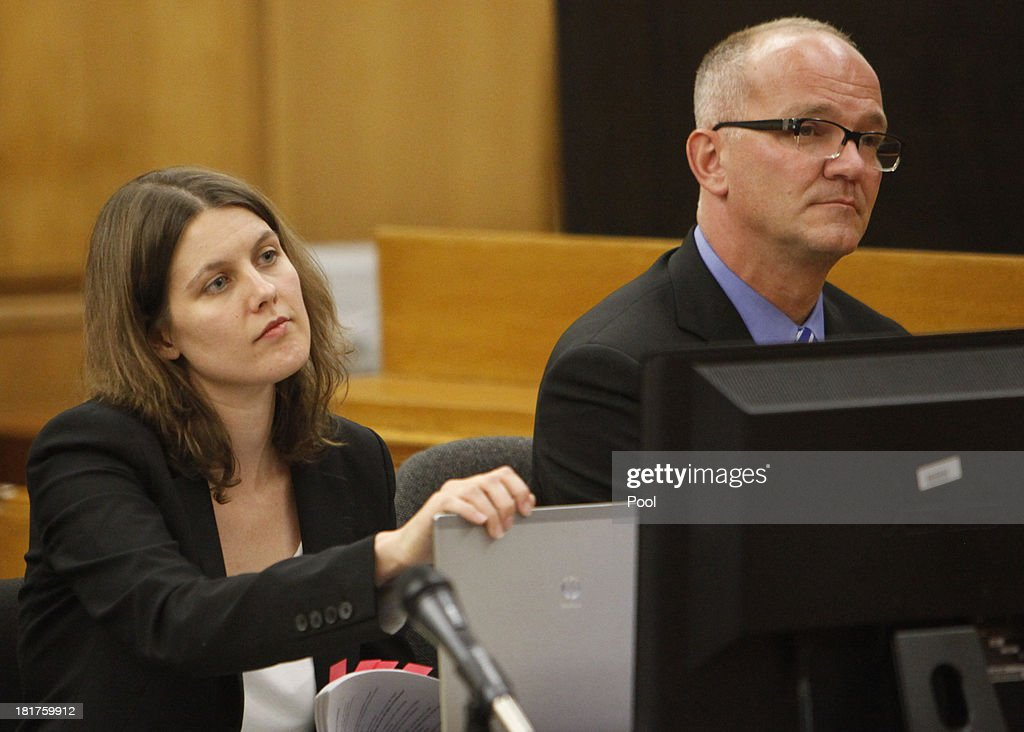 Marvin Putnam, lead attorney for AEG Live LLC and co-counsel Jessica Stebbins-Bina listen to closing arguments by Michael Jackson family attorney Brian Panish in a packed courtroom September 24, 2013 in downtown Los Angeles, California. The Jackson family is suing concert promoter AEG for damages following the pop star's death. AEG is scheduled to give closing remarks tomorrow.