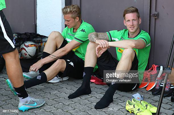 Marvin Schulz and Andre Hahn of Borussia Moenchengladbach sitting before a training session at day five of Borussia Moenchengladbach training camp on...