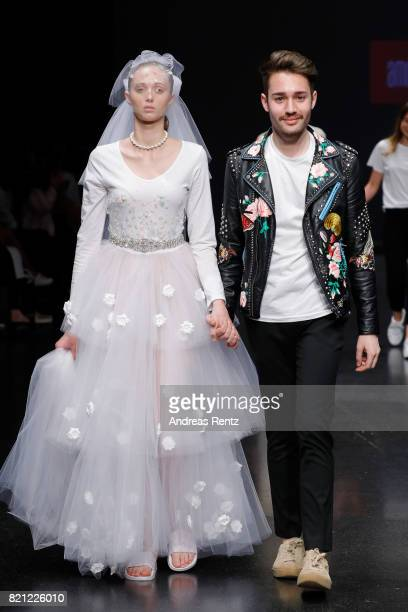 Marvin Singh acknowledges the audience's applause on the runway after his show 'Wonderland' at the AMD Exit17_2 show during Platform Fashion July...
