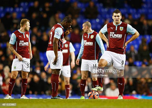 Marvin Sordell and Sam Vokes of Burnley prepare to restart as Paulinho of Spurs scores their first goal during the FA Cup Third Round Replay match...