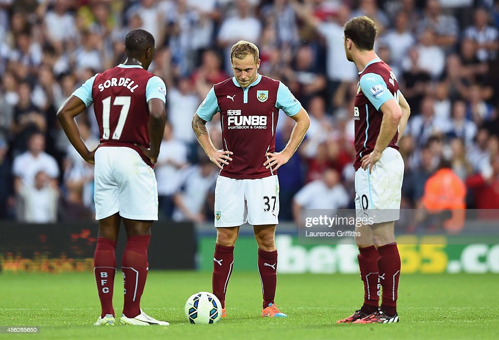 Marvin Sordell Scott Arfield and Ashley Barnes of Burnley show their dejection after conceding a goal during the Barclays Premier League match...