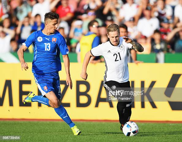 Marvin Stefaniak of Germany is challenged by Lubomir Satka of Slovakia during the Under21 friendly match between U21 Germany and U21 Slovakia at...